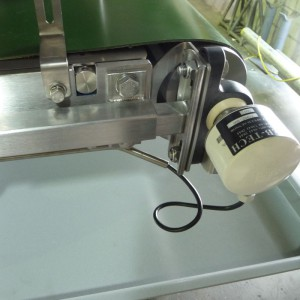 a digital encoder or speed sensor mounted on the tail pulley of a weigh conveyor or weigh belt feeder